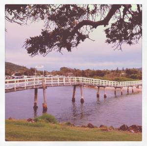 Pretty bridge to walk over the creek to the beach