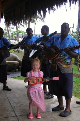 Grace playing guitar with her friends.