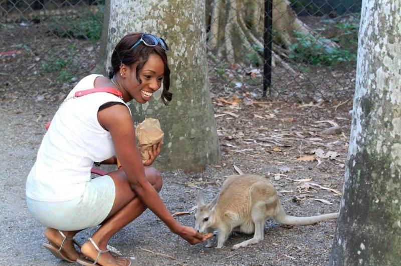 Feeding one of the many tame animals at the wildlife habitat