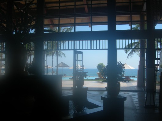 Looking out towards the pool and beach area at Swiss--Belhotel Golden Sands Resort.