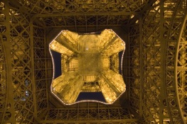 Paris Eiffel Tower at night Looking up from inside