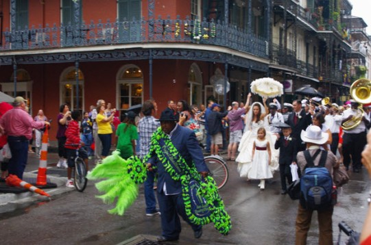 A wedding procession through the streets of New Orleans