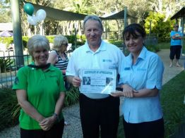 Sharon from The Koala Hospital presents a certificate of appreciation to Tony Terlecki and Suzy Berry of Wyndham Resort